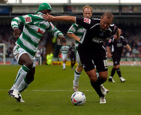 Photo: Alan Crowhurst.<br />Yeovil Town v Swansea. Coca Cola League 1. 08/10/2005. Lee Trundle (R) of Swansea is hassled by Efetobore Sodje.