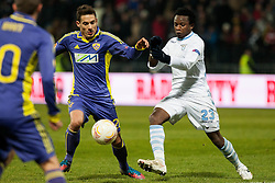 Goran Cvijanovic #20 of Maribor and Ogenyi Onazi #23 of S.S. Lazio during football match between NK Maribor and S. S. Lazio Roma  (ITA) in 6th Round of Group Stage of UEFA Europa league 2013, on December 6, 2012 in Stadium Ljudski vrt, Maribor, Slovenia. (Photo By Gregor Krajncic / Sportida)