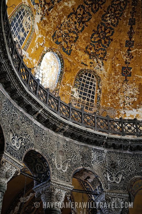 Worn details of the interior of Hagia Sophia. Originally built as a Christian cathedral, then converted to a Muslim mosque in the 15th century, and now a museum (since 1935), the Hagia Sophia is one of the oldest and grandest buildings in Istanbul. For a thousand years, it was the largest cathedral in the world and is regarded as the crowning achievement of Byzantine architecture.