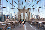 Crossing the Brooklyn Bridge in New York City.