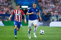 Fernando Torres of Atletico de Madrid competes for the ball with Robert Huth of Leicester City Football Club  during the match of  Champions LEague between  Atletico de Madrid and LEicester City Football Club at Vicente Calderon  Stadium  in Madrid, Spain. April 12, 2017. (ALTERPHOTOS / Rodrigo Jimenez)
