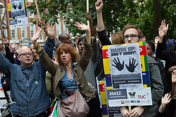 """© Licensed to London News Pictures. 27/08/2014. London, UK. Demonstrators from Stand up to Racism take part in a """"Hands Up, Don't Shoot, Justice for Michael Brown"""" protest outside the US Embassy in London on 27th August 2014. The unarmed black teenager, Michael Brown was fatally shot by a white police officer in Ferguson, Missouri in the United States (US) of America on 9th August 2014.. Photo credit : Vickie Flores/LNP"""
