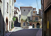 Attractive historic buildings in village street of Venasque,  Vaucluse, Provence, France 1974
