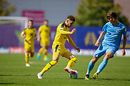Oxford United midfielder Marcus Browne (10) goes past Coventry City midfielder Tom Bayliss (20) during the EFL Sky Bet League 1 match between Oxford United and Coventry City at the Kassam Stadium, Oxford, England on 9 September 2018.