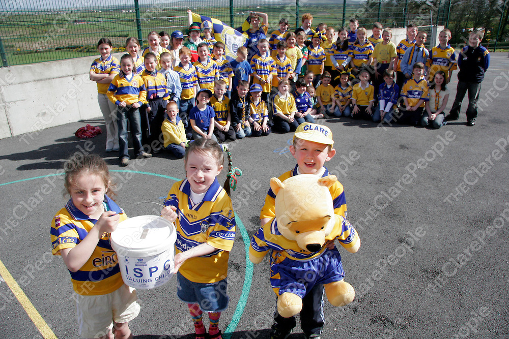 Nichole O'Doherty, Claudia Doohan and Kieran O'Brien with the rest of their Mullagh N.S classmates who had a Clare Day in school during the week in aid of the ISPCC.<br /> <br /> <br /> <br /> Photograph by Yvonne Vaughan.