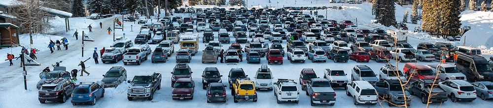 Skiers and snowboarders get ready in the parking lot for the opening day at Grand Targhee Resort on Friday.