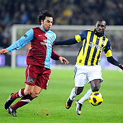 Fenerbahce's Mamadou NIANG (R) and Trabzonspor's Selcuk INAN (L) during their Turkish superleague soccer derby match Fenerbahce between Trabzonspor at the Sukru Saracaoglu stadium in Istanbul Turkey on Sunday 30 January 2011. Photo by TURKPIX