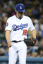 May 11, 2018 - Los Angeles, CA, U.S. - LOS ANGELES, CA - MAY 11: Los Angeles Dodgers Pitcher Kenta Maeda (18) makes the long walk back tot he dugout after being pulled after giving up five earned runs in 4 1/3 innings in the game between the Cincinnati Reds and the Los Angeles Dodgers on May 11, 2018 at Dodger Stadium in Los Angeles, CA.. (Photo by Peter Joneleit/Icon Sportswire) (Credit Image: © Peter Joneleit/Icon SMI via ZUMA Press)