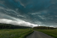 I escaped just ahead of this severe storm near Lewistown, Montana. But I had to stop at this road when I saw the view.