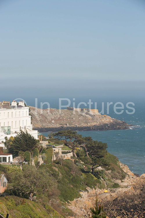 Coastal path overlooking Hawk Cliff on 08th April 2017 in County Dublin, Republic of Ireland. Dalkey is one of the most affluent suburbs of Dublin, and a seaside resort just south of Dublin City, Ireland. It was founded as a Viking settlement and became an active port during the Middle Ages.