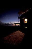 Lit palapa at twilight along the coast of Michoacan, Mexico.
