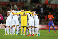 Swansea city players huddle together before k/o. EFL Cup. 3rd round match, Swansea city v Manchester city at the Liberty Stadium in Swansea, South Wales on Wednesday 21st September 2016.<br /> pic by  Andrew Orchard, Andrew Orchard sports photography.