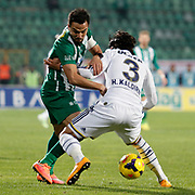 Bursaspor's Volkan Sen (L) during the Turkish soccer super league match Bursaspor between Fenerbahce at the Ataturk Stadium in Bursa Turkey on Monday, 24 November 2014. Photo by Aykut AKICI/TURKPIX