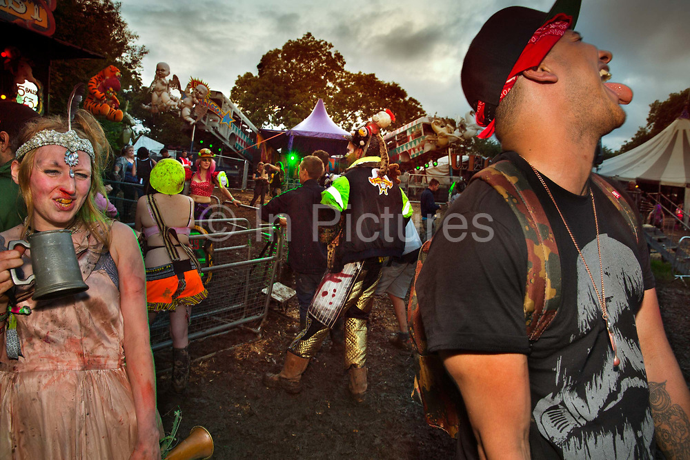 Moments after a kiss in the Unfairground, Glastonbury Festival 2016. Glastonbury Festival is the largest greenfield festival in the world, and is now attended by around 175,000 people. Its a five-day music festival that takes place near Pilton, Somerset, United Kingdom. In addition to contemporary music, the festival hosts dance, comedy, theatre, circus, cabaret, and other arts. Held at Worthy Farm in Pilton, leading pop and rock artists have headlined, alongside thousands of others appearing on smaller stages and performance areas.
