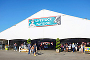 People Walking Through The Livestock Pavilion at the OC Fair