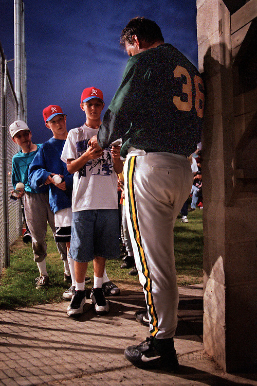 Former major league catcher Terry Steinbach, now playing for the New Ulm amateur team, signs autographs for young fans following a game. After retiring  from the Twins in 1999, Steinbach has returned to end his career where he started it, playing for his hometown team..