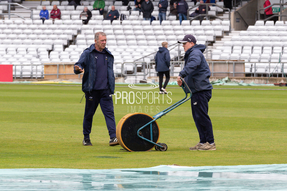 The mopping up operation begins as ground staff clear up after the rain storm at Emerald Headingley ahead of the opening day of the Specsavers County Champ Div 1 match between Yorkshire County Cricket Club and Hampshire County Cricket Club at Headingley Stadium, Headingley, United Kingdom on 27 May 2019.