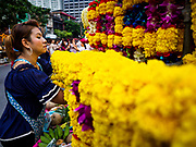 30 SEPTEMBER 2017 - BANGKOK, THAILAND:  A woman sells marigolds used as offerings before the Navratri parade in Bangkok. Navratri is a nine night (10 day) long Hindu celebration that marks the end of the monsoon and honors of the divine feminine Devi (Durga). The festival is celebrated differently in different parts of India, but the common theme is the battle and victory of Good over Evil based on a regionally famous epic or legend such as the Ramayana or the Devi Mahatmya. Navratri is celebrated throughout Southeast Asia in communities that have large Hindu population. Bangkok's celebration of Navratri was subdued this year because Thais are still mourning the death of Bhumibol Adulyadej, the Late King of Thailand, who died on October 13, 2016.     PHOTO BY JACK KURTZ