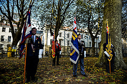Royal British Legion standard bearers stand on parade during a Remembrance Sunday service in Queen's Square, Bristol, held in tribute for members of the armed forces who have died in major conflicts.