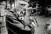 Antwerp, Belgium, 2001, Portrait of a proud man and his little dog. PHOTO © Christophe VANDER EECKEN