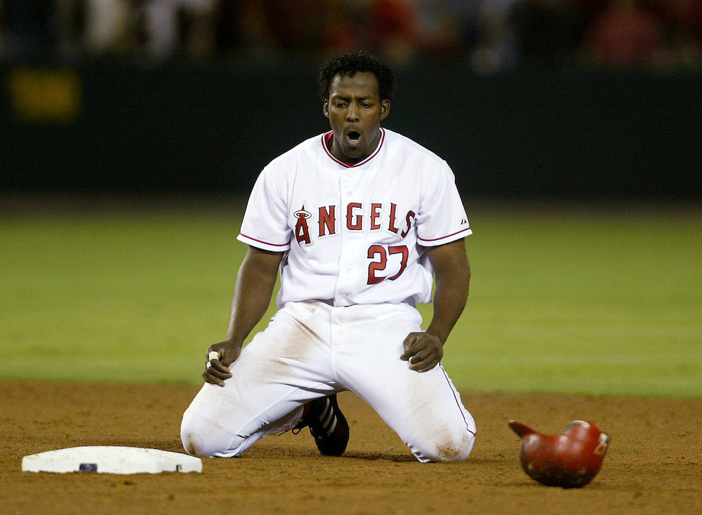 The Anaheim Angels' Vladimir Guerrero shows his frustration after getting caught in a rundown to end the sixth inning against the Oakland Athletics at Angel Stadium Wednesday June 23, 2004.