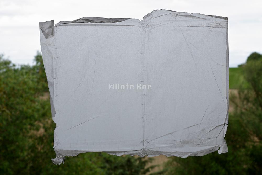 semi transparent paper blocking view towards rural countryside landscape