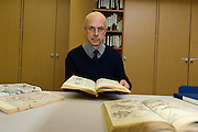 Time Clark, exhibition curator with books of shunga prints. Shunga: sex and pleasure in Japanese art, The British Museum, London, UK, October 29, 2013.