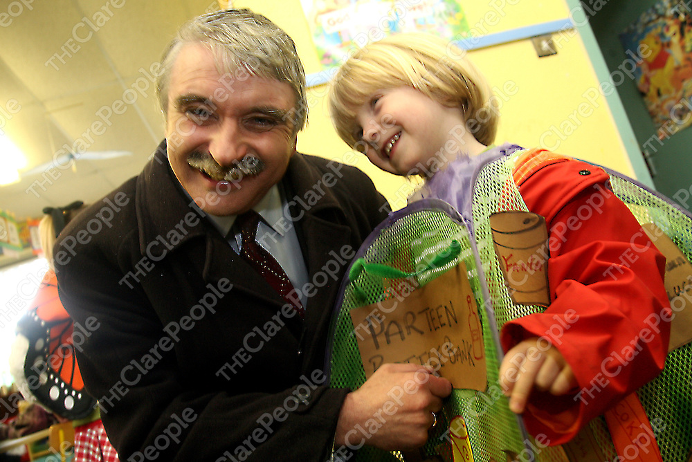 Young Samuel Maloney from Parteen National School tells Willie O' Dea about his costume after the Minister for Defence raised their first Green Flag on Friday.<br /> Photograph by Yvonne Vaughan