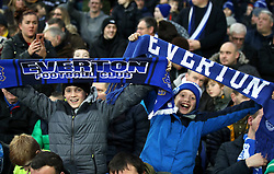 Everton fans show their support during the Emirates FA Cup, third round match at Goodison Park, Liverpool.