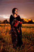 Darina wrapped herself in a Native American blanket, and posed for late afternoon portraits in a Taos, New Mexico sunset