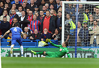 Football - 2016 / 2017 Premier League - Chelsea vs. Crystal Palace<br /> <br /> Cesc Fabregas of Chelsea scores his first half goal past Wayne Hennessey at Stamford Bridge.<br /> <br /> COLORSPORT/ANDREW COWIE