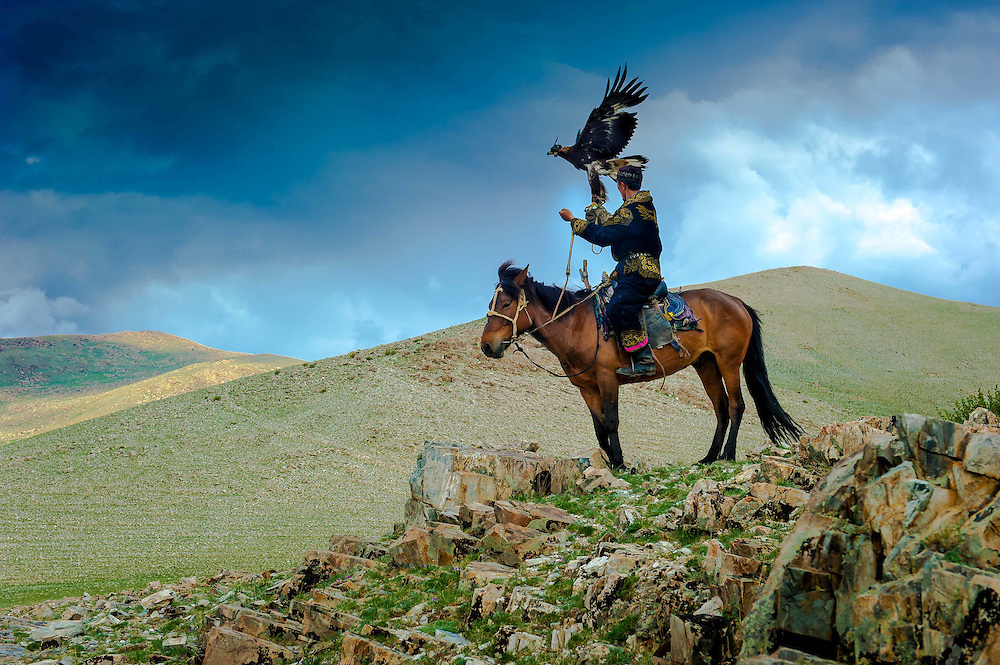 """The Eagle Hunters of Mongolia. In the Altai Mountains of Mongolia, Kazakh tribes still hunt fox and wolf with golden eagles. The Kazakh are a semi-nomadic people who raise sheep and yaks for their main food source.<br /> Genghis Khan is said to have had over 5,000 """"eagle riders"""" in his personal guard."""