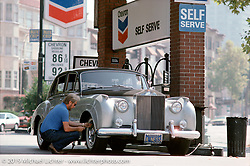 Arlen Ness filling the air in the tires of his 1959 Rolls Royce Silver Cloud, San Fransico, CA. Photograph ©Michael Lichter 1987