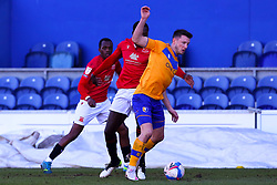 Toumani Diagouraga of Morecambe chases down Ollie Clarke of Mansfield Town - Mandatory by-line: Ryan Crockett/JMP - 27/02/2021 - FOOTBALL - One Call Stadium - Mansfield, England - Mansfield Town v Morecambe - Sky Bet League Two