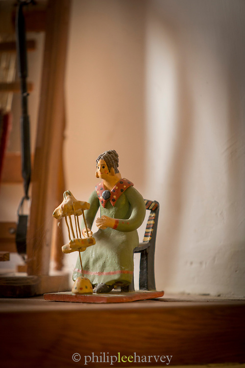 Close-up of figurine of woman with loom, Pampaneira, Andalusia, Spain