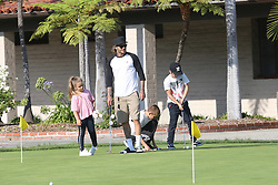 EXCLUSIVE: David Beckham enjoyed an afternoon with Romeo, Cruz and Harper at the golf course on Friday. Doting dad David was seen affectionately comforting Harper planting a kiss on her lips as she appeared to be upset at one point. 04 Aug 2017 Pictured: David Beckham, Harper, Romeo, Cruz. Photo credit: Rachpoot/MEGA TheMegaAgency.com +1 888 505 6342