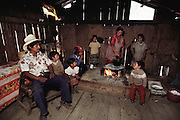 Artemio Martinez family getting ready for breakfast in their simple house near the Monarch butterfly reserve. Rosario, Mexico.