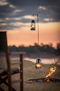 Camp fire at sunset by Luangwa River in South Luangwa National Park, Zambia