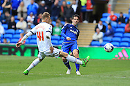 Peter Whittingham of Cardiff city ® passes past Oscar Threlkeld of Bolton. Skybet football league championship match, Cardiff city v Bolton Wanderers at the Cardiff city Stadium in Cardiff, South Wales on Saturday 23rd April 2016.<br /> pic by Andrew Orchard, Andrew Orchard sports photography.