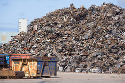 stack of scrap metal piled up on dockside at Liverpool docks; England,