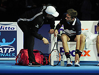 Tennis - 2018 Nitto ATP Finals at The O2 - Day Two<br /> <br /> Group Doubles Group Llodra/Santoro: Oliver Marach (AUT) & Mate Pavic (CRO) vs. Pierre - Hughes Herbert (FRA) & Nicolas Mahut (FRA)<br />  <br /> Nicolas Mahut talks to his coach as he struggles with an ankle injury in between games<br /> <br /> <br /> COLORSPORT/ANDREW COWIE