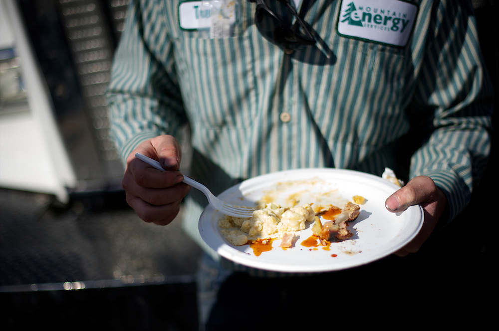 An employee of Mountain Energy Services eats during a rally for Republican Presidential candidate Mitt Romney, held on the company's site, in Tunkhannock, Pennsylvania on April 5, 2012.