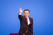Chinese premier Li Keqiang waves to the media before taking a seat at his press conference on the closing day of the 12th National Peoples Congress NPC at the Great Hall of the People in Beijing, China, on Wednesday, March 16, 2016.