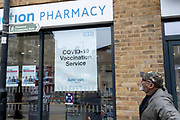 A south Londoner leaves a south London Pharmacy after his pre-arranged Covid-19 vaccinations during the third lockdown of the Coronavirus pandemic, on 2nd March 2021, in London, England.