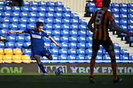 AFC Wimbledon midfielder George Dobson (24) shoots at goal during the EFL Sky Bet League 1 match between AFC Wimbledon and Hull City at Plough Lane, London, United Kingdom on 27 February 2021.