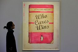 "© Licensed to London News Pictures. 12/10/2017. London, UK.  A staff member views ""Who Cares Wins"", 2017, by Harland Miller (Est. GBP20-25k) at a preview of artworks for the ""Art for Grenfell"" auction taking place at Sotheby's, New Bond Street, on 16 October.  Leading contemporary artists have agreed to donate works to the auction, the proceeds of which will be divided equally amongst the 158 surviving families of the Grenfell Tower fire by the Rugby Portobello Trust charity. Photo credit : Stephen Chung/LNP"