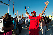 Jarvas Wright walks during a protest at Craig Ranch North in response to an incident with teens and police officers at a community pool in McKinney, Texas on June 8, 2015.  (Cooper Neill for The New York Times)