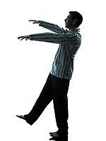 one man in pajamas sleepwalker sleepwalking silhouettes on white background