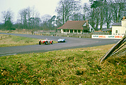 "British Sports racing driver Bill de Selincourt (1921-2014) driving Lister-Jaguar "" Knobbly"" car ( blue car), BARC event at Oulton Park circuit, Cheshire, England 17th March 1962"