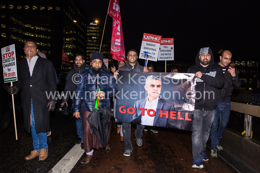 London, UK. 4th February, 2019. Hundreds of Uber minicab drivers block London Bridge as part of a protest organised by the United Private Hire Drivers (UPHD) branch of the Independent Workers Union of Great Britain's (IWGB)  following the introduction in December of congestion charges for minicabs.